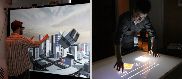 A man interacting with a 3D cityscape with his hands, A man using a table display