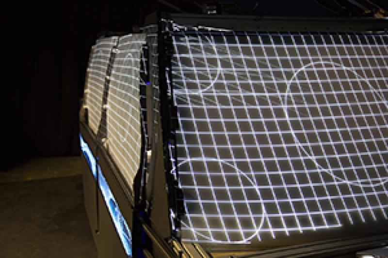 Autonomous vehicle buck exterior with light projections on windows