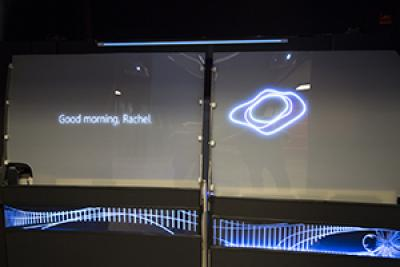 "Interior view of the buck showing projected text ""good morning, Rachel"" message on window"